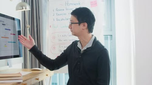 Asia middle-aged male business teacher video conference looking at camera talk by webcam learn.