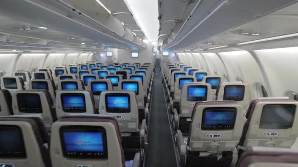 Cover Image for Jet Airplane Interior View Economy Class Monitors on Seats