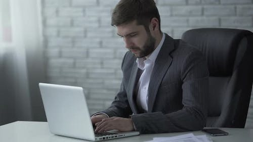 Respectable Man Typing on Laptop, Communicating With Important Business Client