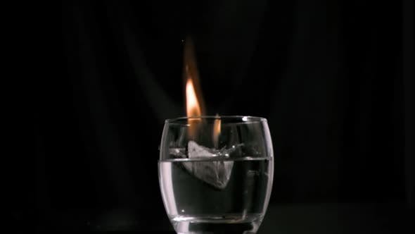Coal burning in super slow motion in a glass