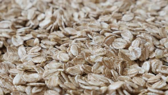 Thumbnail for Rye flakes on table close-up slow pan 4K 2160p 30fps UltraHD footage - Panning on groats made nutrit