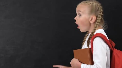 Excited Girl Pointing Finger Into Blackboard, School Lessons, Template for Text