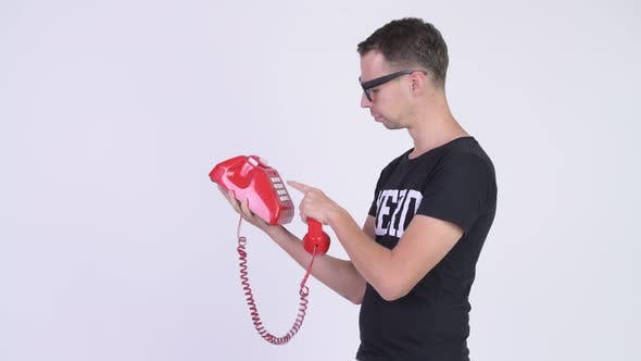 Cover Image for Studio Shot of Angry Nerd Man Shouting on Telephone