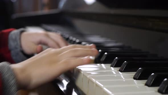 Thumbnail for Hands of Kid on Piano Keyboard