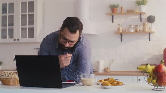 Cover Image for Man Having Phone Call During Breakfast