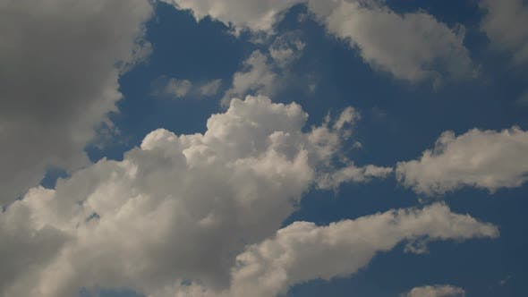 Thumbnail for Speedy Cumulus Rain Clouds Moving Blue Sky