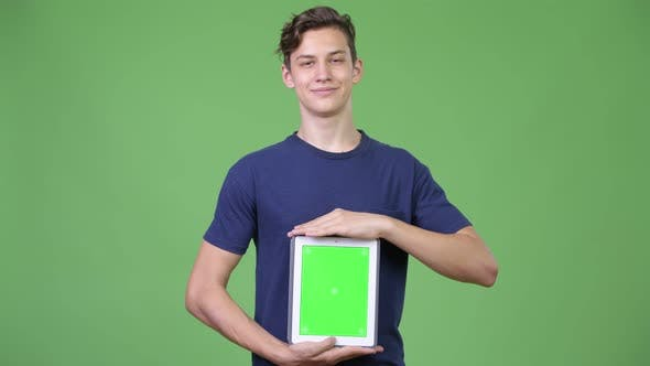 Cover Image for Young Handsome Teenage Boy Showing Digital Tablet