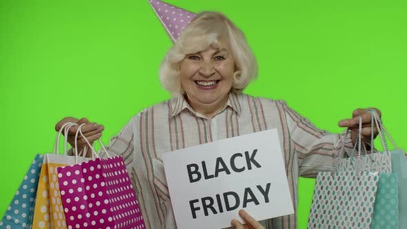 Thumbnail for Inscription Advertising Black Friday Appears Next To Joyful Grandmother with Shopping Bags