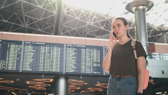 Thumbnail for A Woman at the Airport on the Phone Discussing the Delay of His Flight