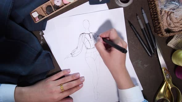Thumbnail for Sketch Creation By Hands of Clothes Designer