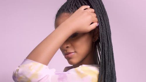 Mixed Race Model with African Hair Braids in Studio Portrait