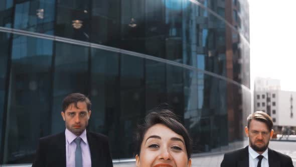 Thumbnail for Businesswoman and Two Businessman Rejoice and Jump with Happiness