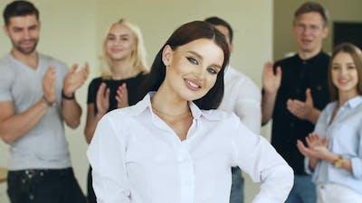 Successful Team of Businessmen Clap Their Hands