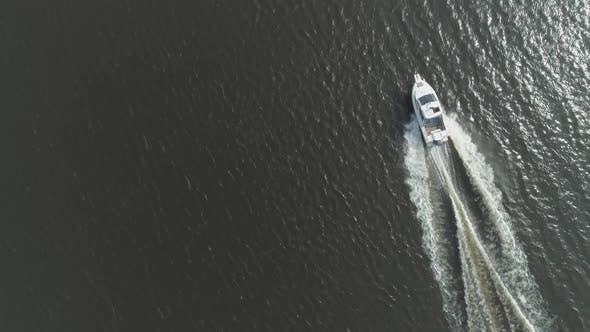 Thumbnail for Luxury Speed Motor Boat in the Sea at Sunny Day. Aerial Vertical Top-Down View