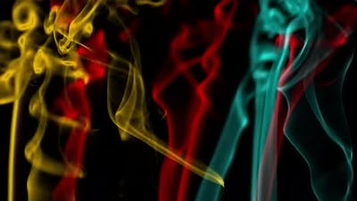 Colored silky smoke on black background