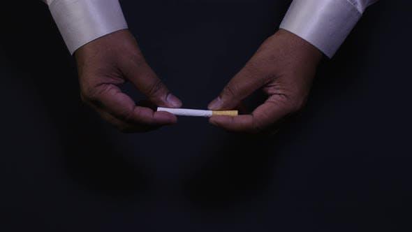 Thumbnail for Hands Break a Cigarette