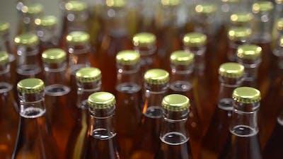 Rotation of Bottles of Lemonade on the Bottling Line