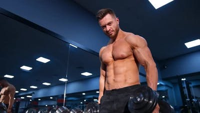 Man Doing Exercises With Dumbbells