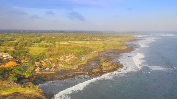 Thumbnail for Famous Tanah Lot Temple on Sea in Bali Island, Indonesia with Blue Sky and Waves. Aerial View