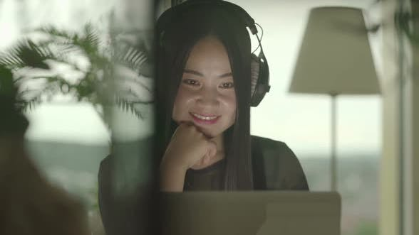 Thumbnail for Happy Female with Headphones Listening to Music