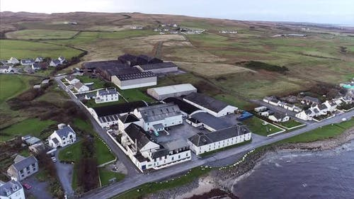 Aerial of a Distillery in Islay Scotland