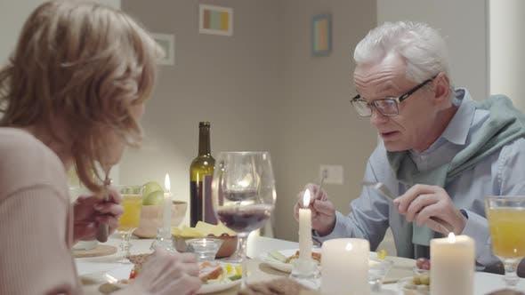 Thumbnail for Elderly Couple Eating Dinner and Speaking