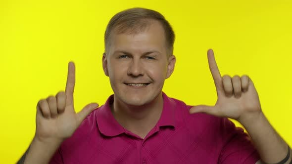 Thumbnail for Portrait of Young Caucasian Man Posing in Pink T-shirt. Happy Handsome Guy Celebrates and Dances