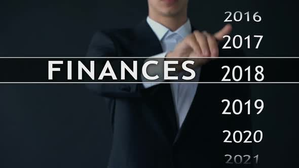 Thumbnail for Businessman Selects 2023 Finances Report on Virtual Screen, Money Statistics