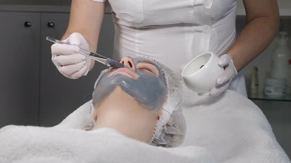 Thumbnail for Female Beauty Concept. Young Woman Gets Facial Mask, Improving Skin Face. Attractive Woman Resting