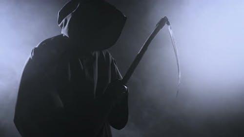 Horrible Dark Figure In A Hoodie With A Scythe