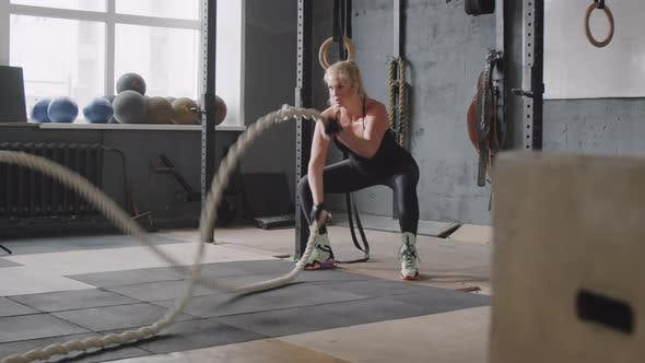 Thumbnail for Sportswoman Doing Battle Ropes Waves in Gym