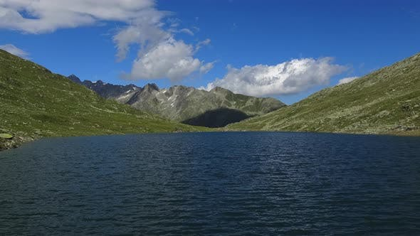 Thumbnail for Timelapse of View on Peak of Mountains and Lake in Swiss Alps