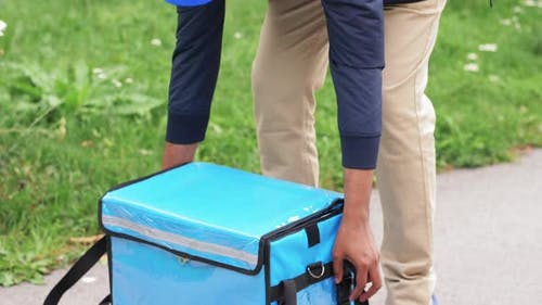 Food Delivery Man Closing Thermal Insulated Bag