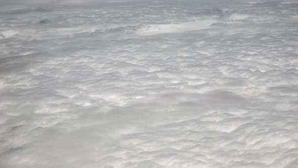 Sunny Landscape Above Clouds From Airplane Window