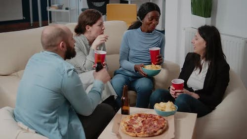 People Enjoying Drinks and Snacks After Work for Leisure