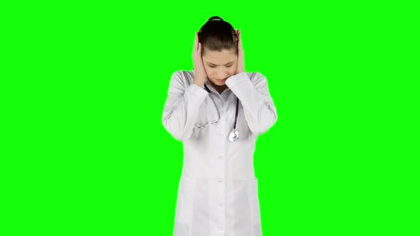 Cover Image for Young Worried Doctor Holding His Head, Green Screen