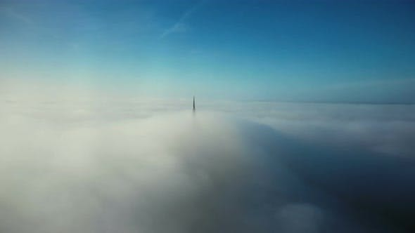 Cover Image for Drone Flying in Clear Blue Sky Clouds Towards Epic Heavenly Golden Castle Steeple Top of Mont Saint