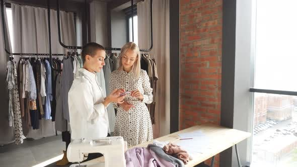 Caucasian Fashion Designer Discuss with Model New Clothing
