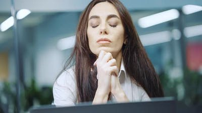 Stressed Employee Sitting in Office