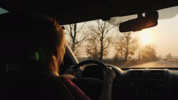 Thumbnail for Silhouette of a Female Driver Driving a Car
