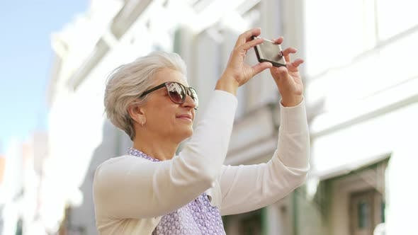 Thumbnail for Senior Woman Photographing By Smartphone in City 49