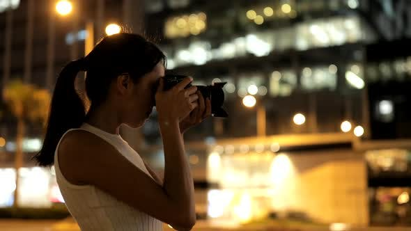 Thumbnail for Female Photographer taking photo in the city