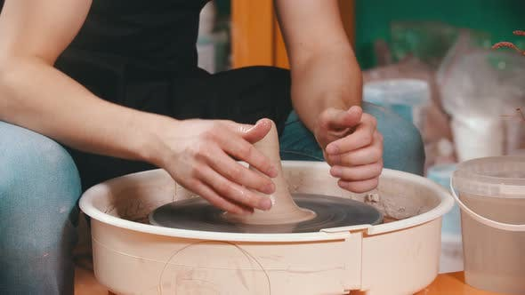 Thumbnail for Pottery - the Master Is Pouring Elongated Clay with Water and Continuing Modeling