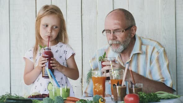 Thumbnail for Grandfather with Granddaughter Tastes Smoothies
