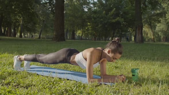 Thumbnail for Woman Doing Planks Exercising Outdoors in Morning