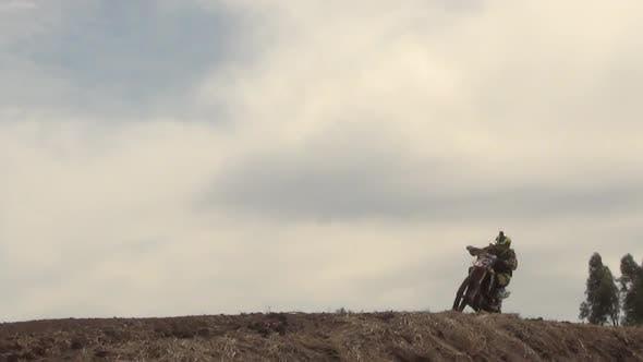 Men racing in a motocross motor sports race.