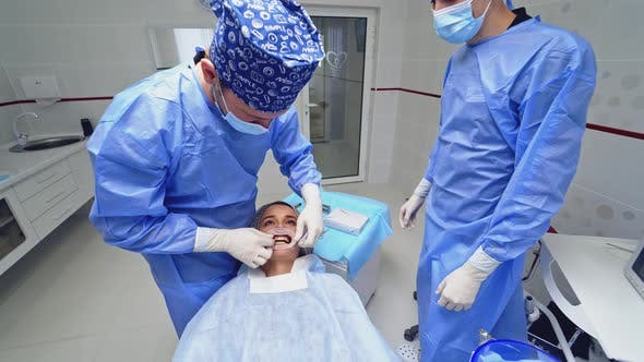 Thumbnail for Dentist Preparing Female Patient For Dental Treatment