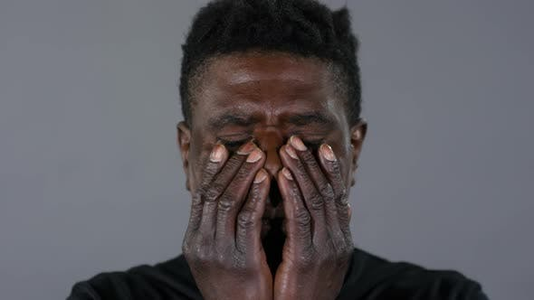 Thumbnail for Despaired African Man Looking at Camera