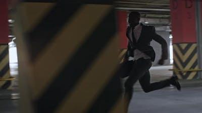 Spy Running in Underground Parking Lot