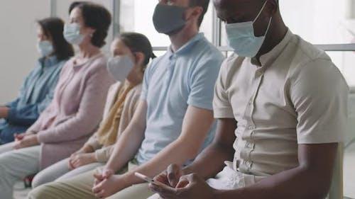 Multiethnic People In Hospital Queue